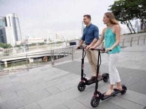 people on electric scooters