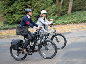people riding ebikes on a commute