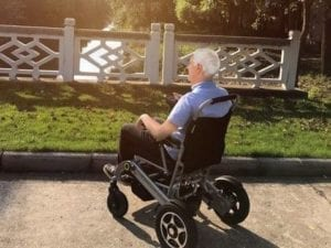 man in electric wheelchair