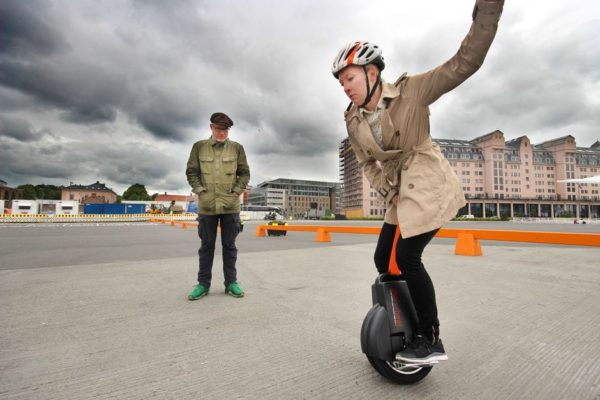 Woman riding airwheel electric unicycle