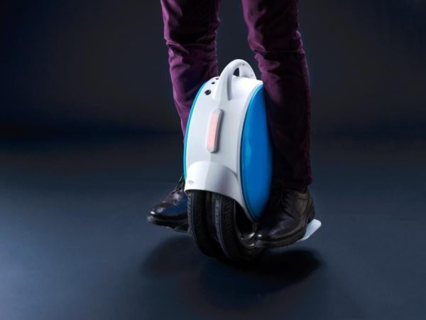 person riding Airwheel Q5 electric unicycle