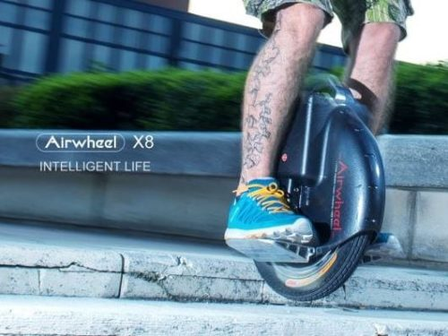 Tattooed man riding airwheel unicycle