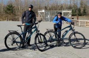 Ali and Paul pose with envo ebikes