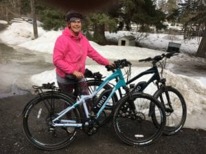 A lady poses with ENVO electric bicycles