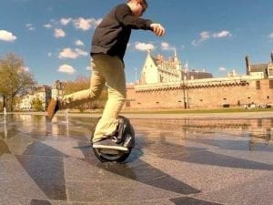 Electric unicycle rider no helmet